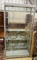A modern glazed shop cabinet a.f., width 100cm, depth 40cm, height 191cm
