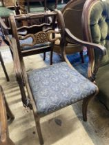 A set of eight Regency style beech dining chairs, two with arms