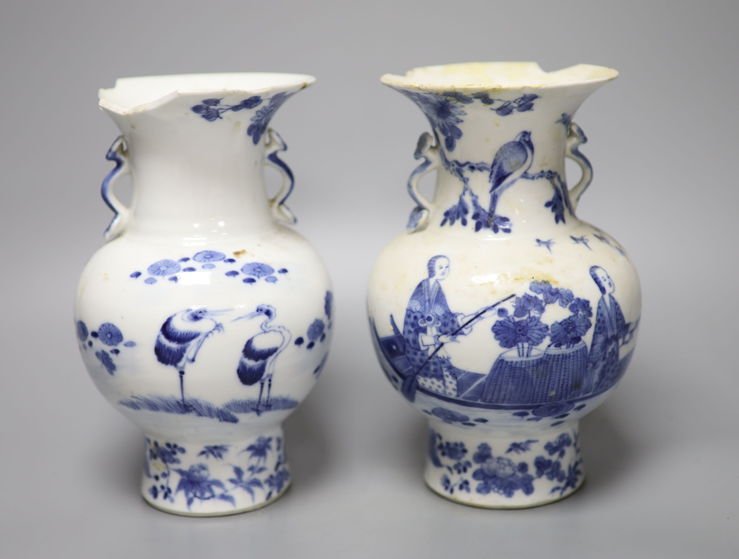A pair of 19th century Chinese blue and white vases (a.f.), 23cm high