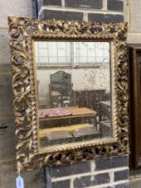 A 19th century Florentine style carved giltwood wall mirror, width 60cm, height 70cm