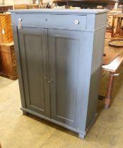 A East European painted pine cabinet, width 98cm, depth 41cm, height 140cm