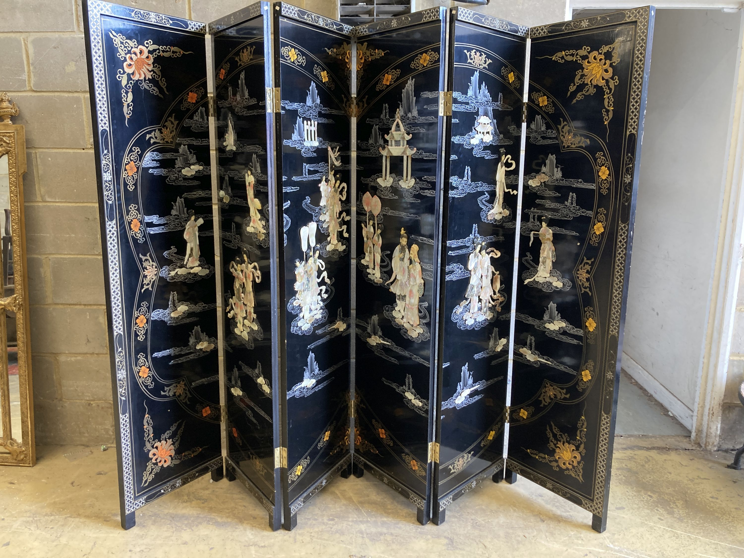 A 1920's - 30s Chinese inlaid mother of pearl six fold screen, each panel 45cm wide, height