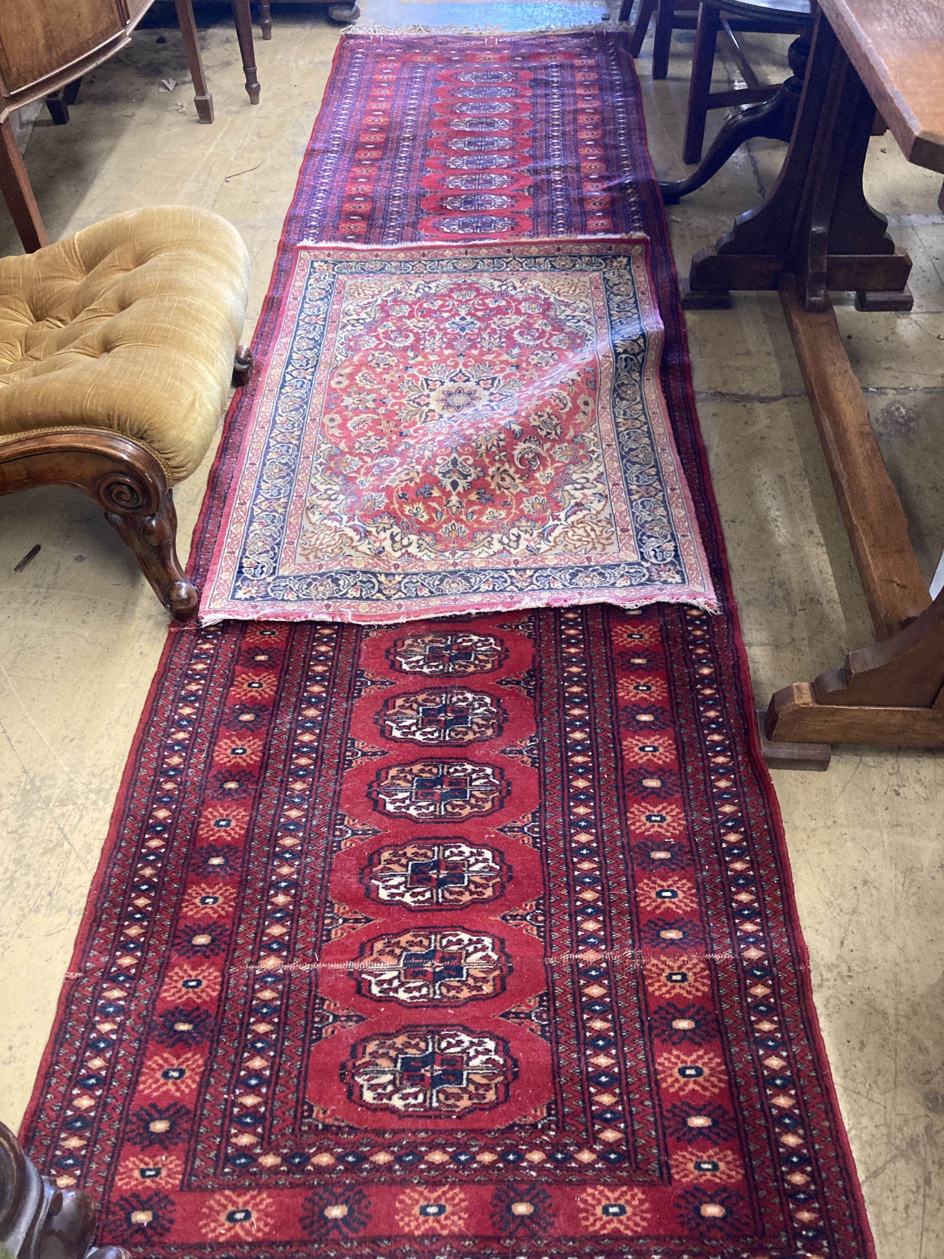 A Bokhara red ground runner, 305 x 80cm, together with a smaller Kashan style rug