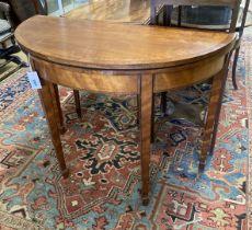 A George III satinwood demi lune folding card table, width 91cm, depth 42cm, height 71cm