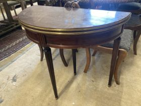 An early 20th century French brass mounted mahogany D shape folding card table, width 91cm, depth
