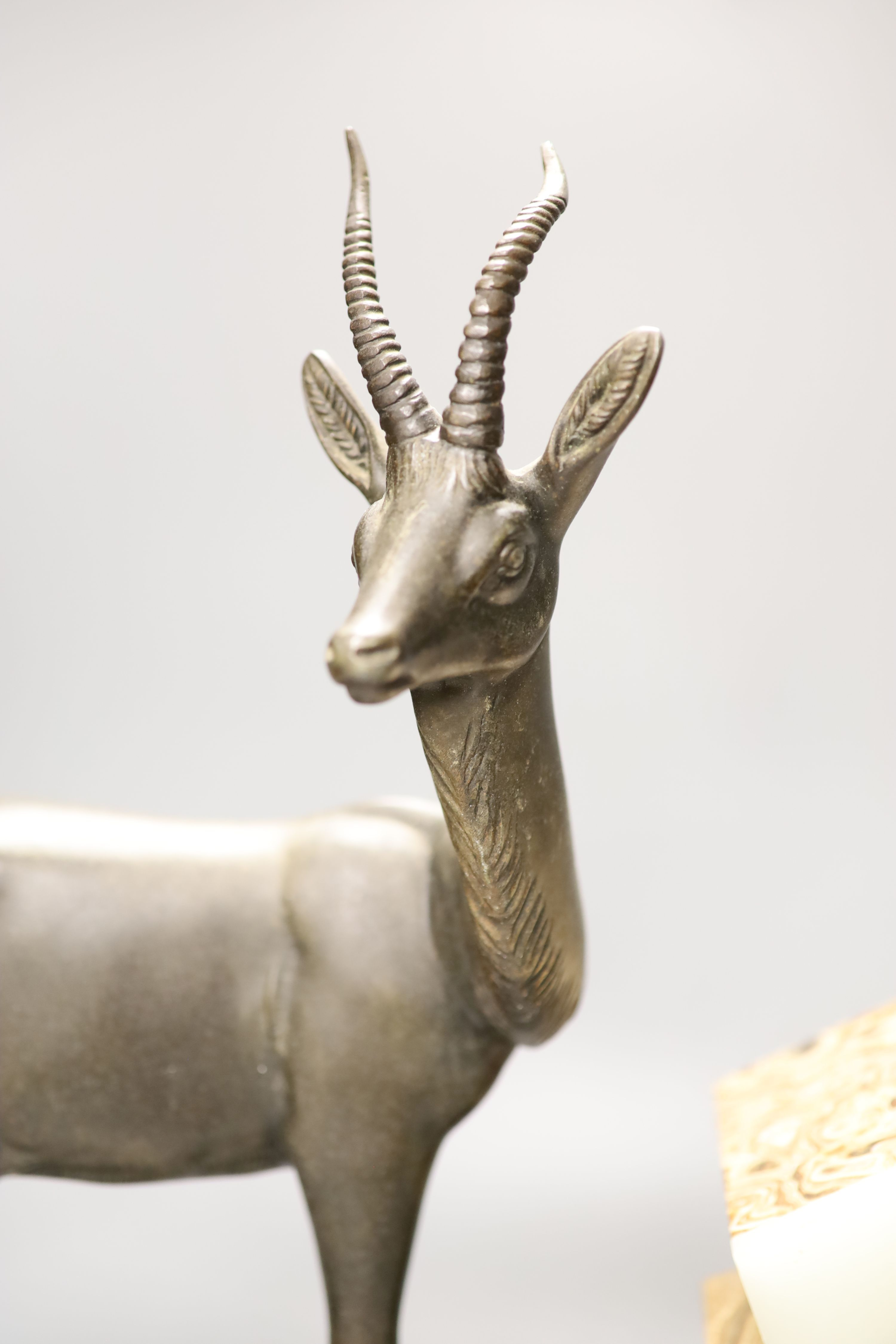 An Art Deco spelter, marble and onyx 'antelope' mantel clock, length 58cm - Image 3 of 5