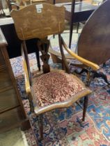 An Art Nouveau marquetry inlaid mahogany and beech elbow chair, width 53cm, depth 54cm, height