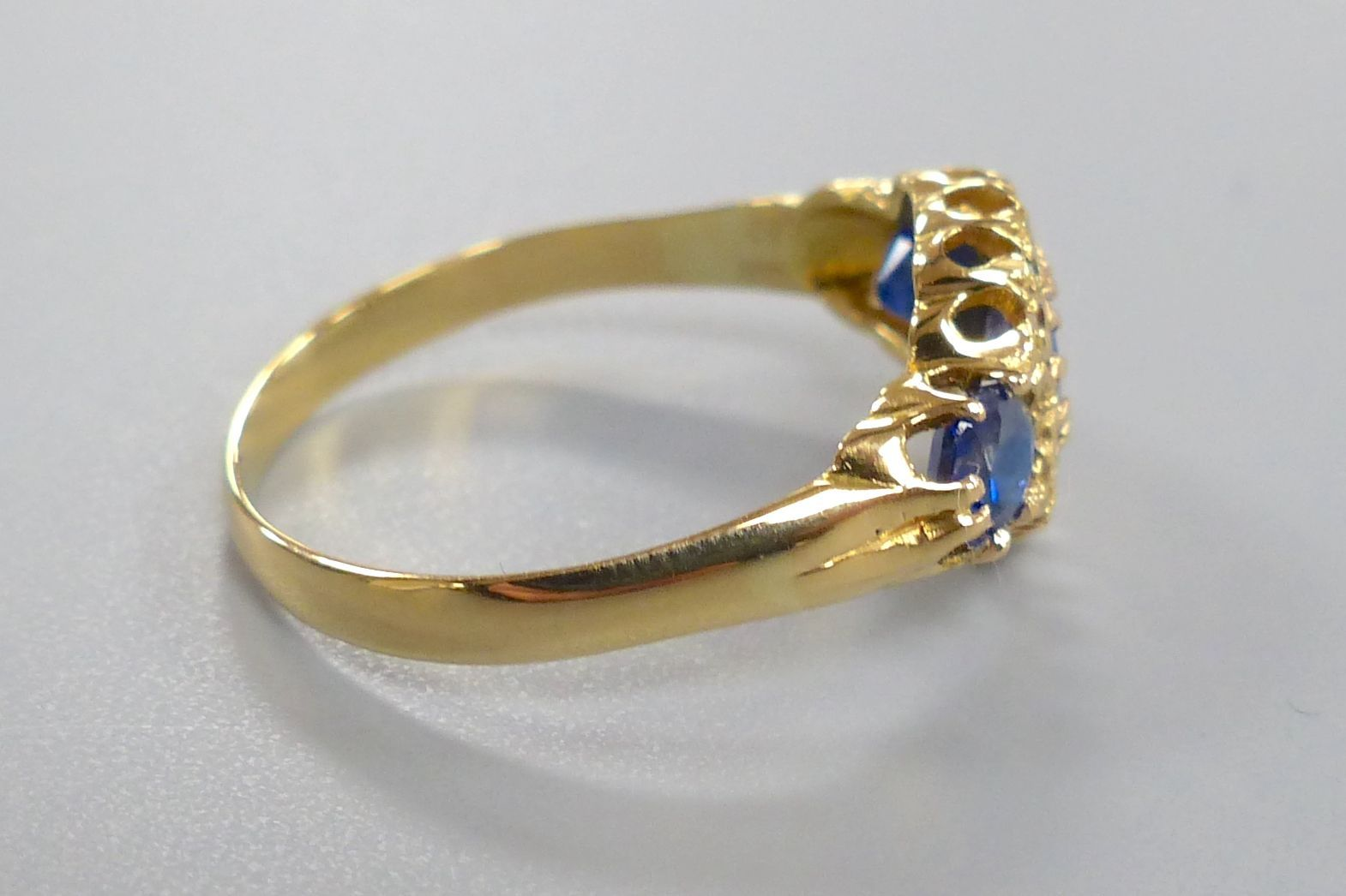 A George V 18ct gold, sapphire and diamond chip cluster dress ring, size R/S, gross 2.7 grams. - Image 2 of 3