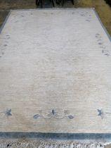 A Chinese beige ground carpet, 340 x 250cm