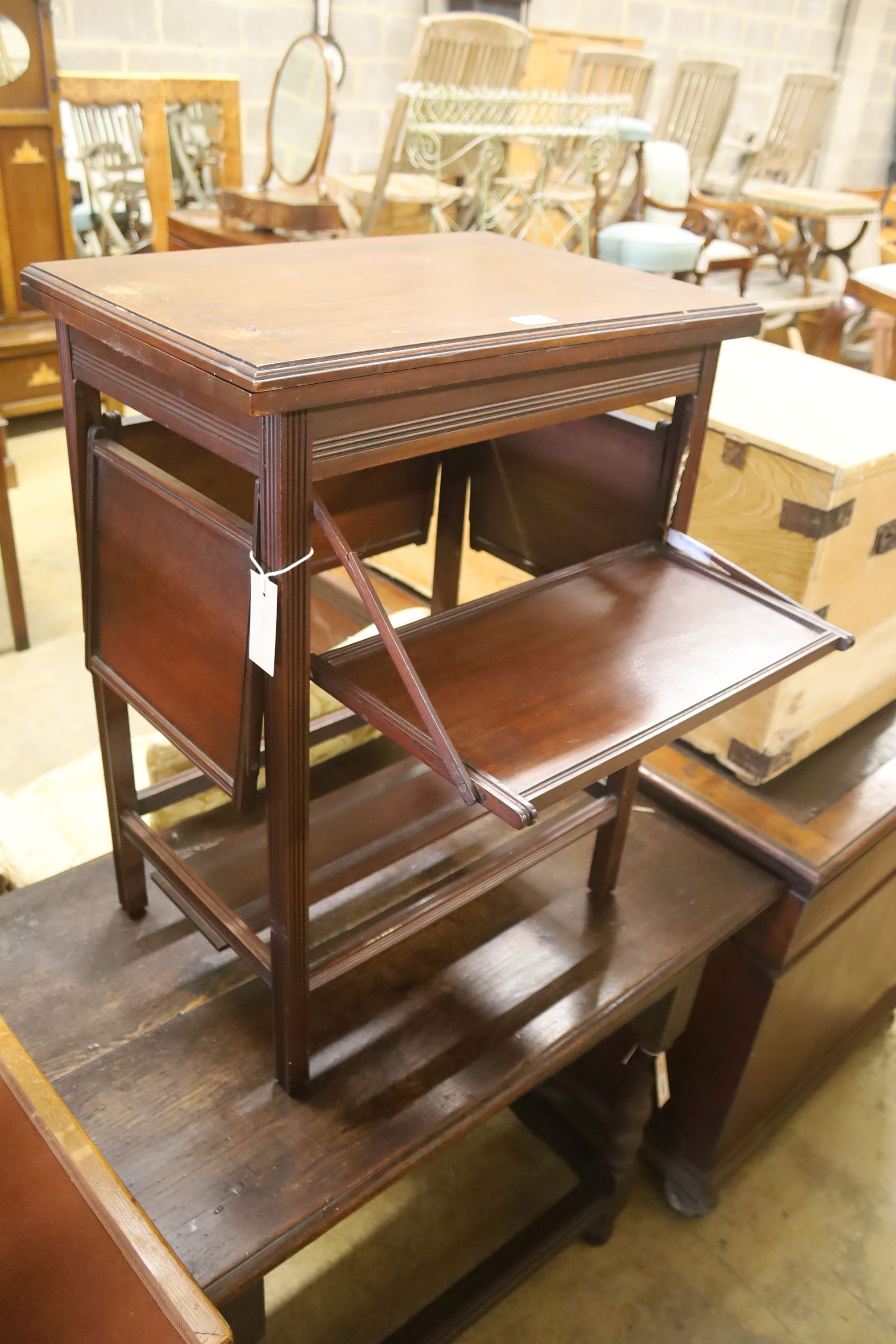 A late Victorian aesthetic movement walnut folding card / occasional table, width 54cm, depth