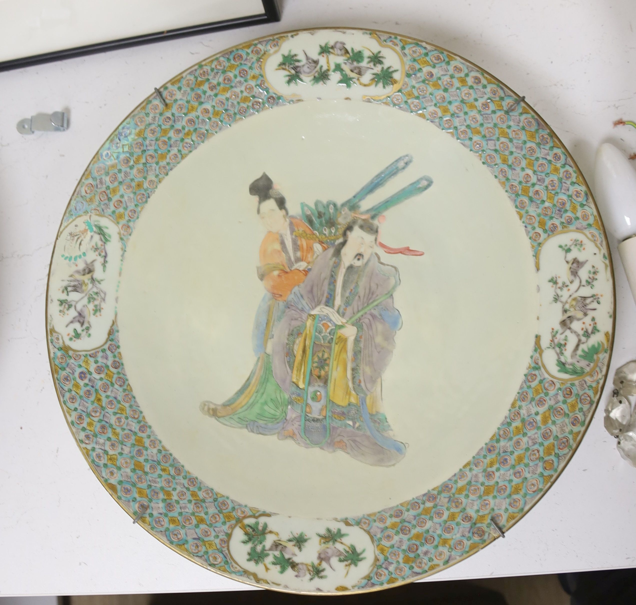 A Chinese enamelled porcelain 'immortals' dish, 19th century, diameter 38cm, restored
