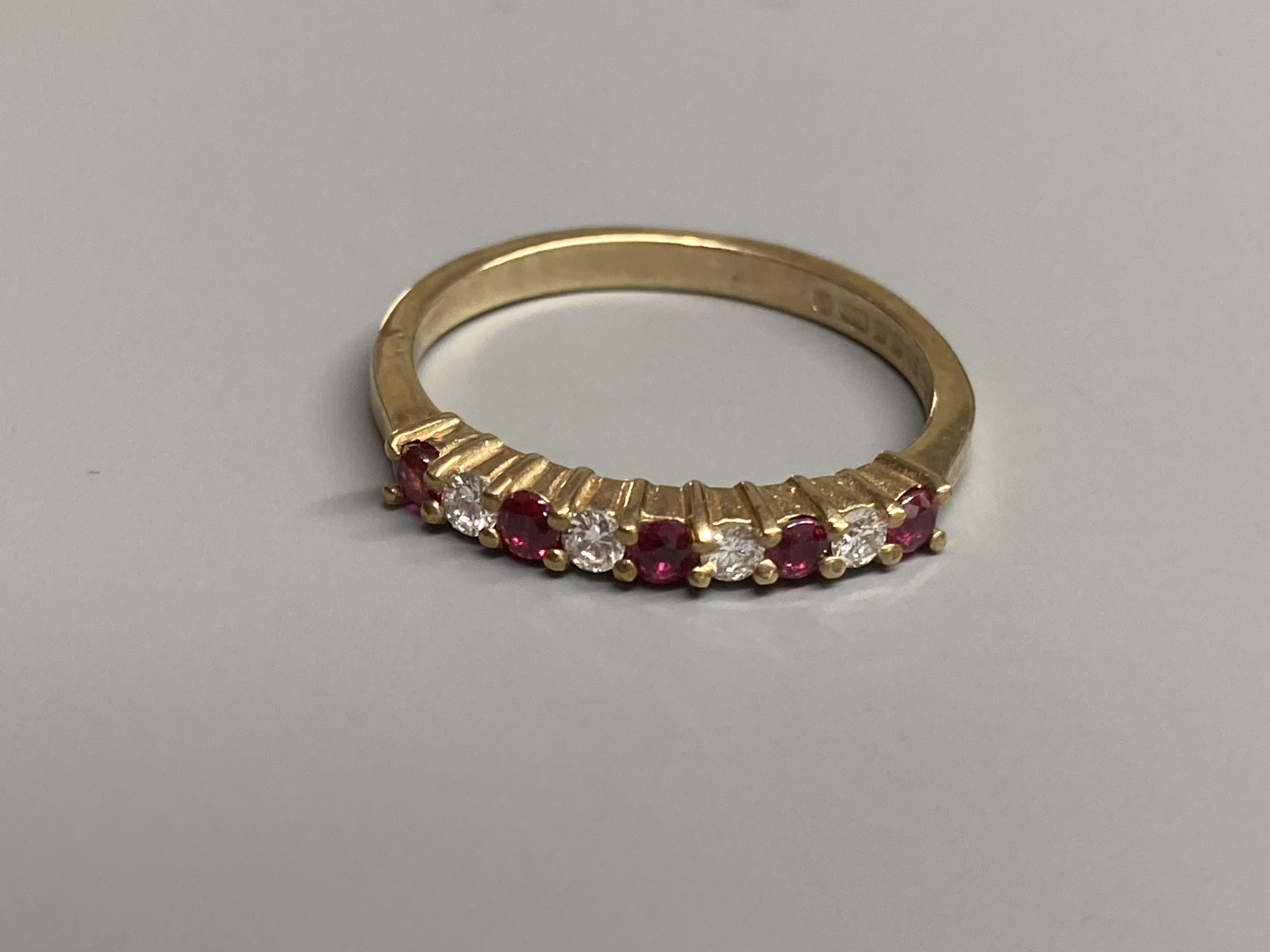 A modern 9ct gold, ruby and diamond set half hoop ring and a similar amethyst ring and two other 9ct - Image 2 of 5