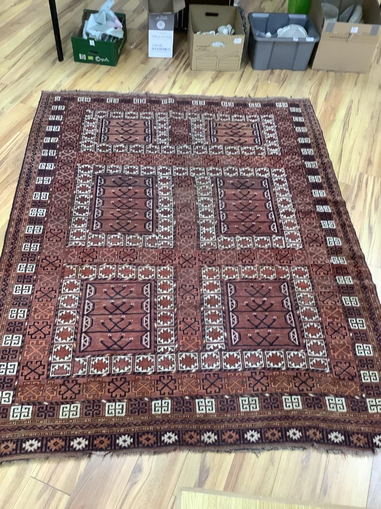 A large Persian rug, 220 x 174cm