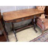 A Regency banded and ebony inlaid walnut writing table, width 106cm, depth 52cm, height 73cm