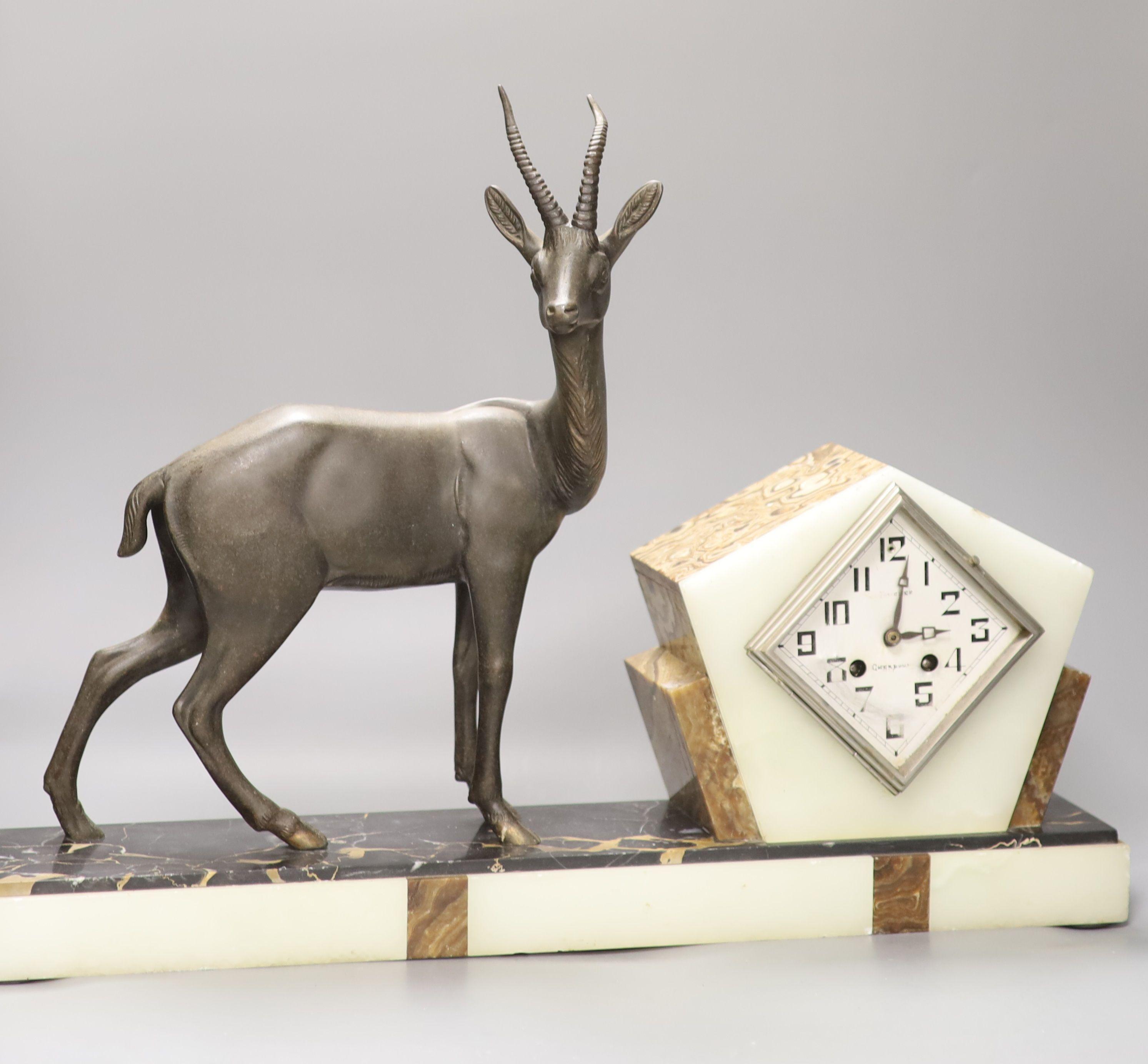 An Art Deco spelter, marble and onyx 'antelope' mantel clock, length 58cm