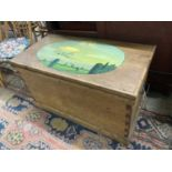 A Victorian stripped pine trunk, the top later painted with an airship scene, length 89cm, depth