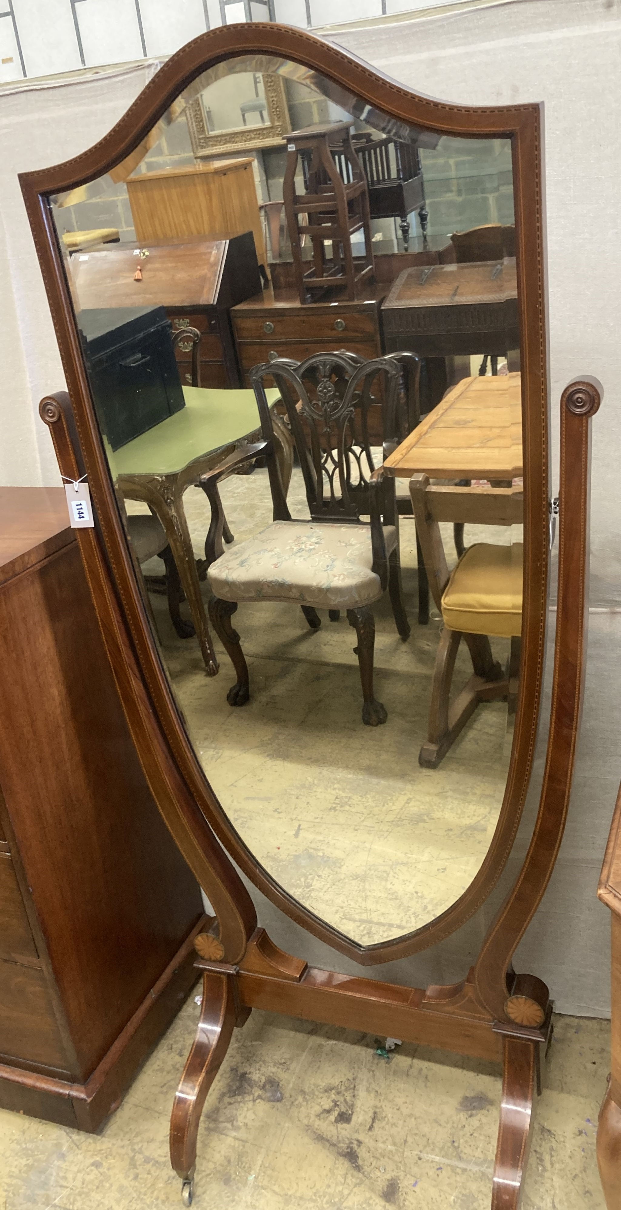 A large Edwardian inlaid mahogany shield shaped cheval mirror, width 80cm, height 177cm