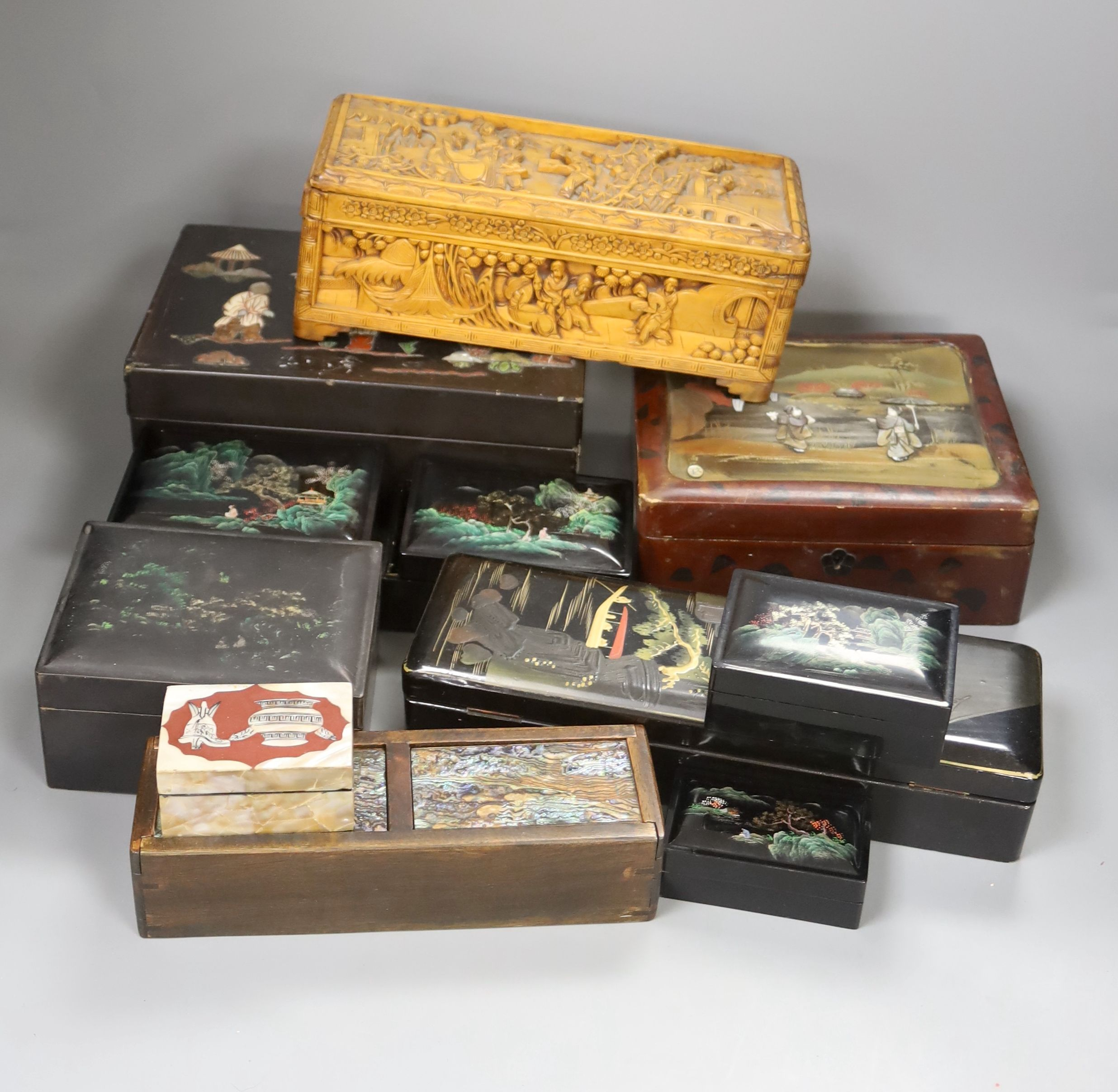 A collection of Chinese lacquered, carved hardwood and other boxes (11)
