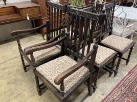 A set of six 1920's oak barleytwist dining chairs, two with arms