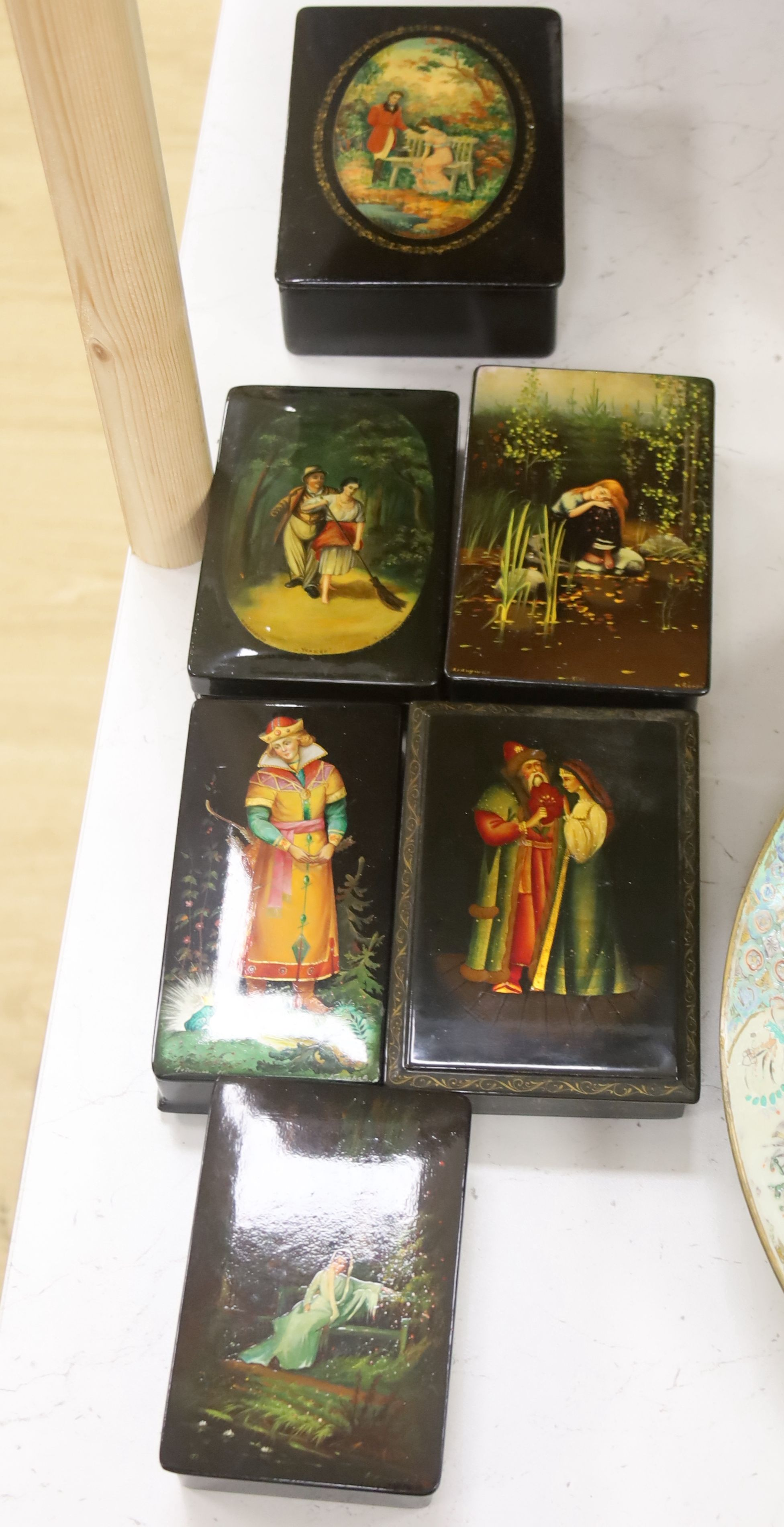 Six Russian painted lacquer boxes, each signed and inscribed, largest 18 x 13cm
