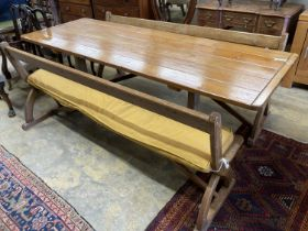 A rectangular pine kitchen table, width 218cm, depth 77cm, height 77cm together with a pair of