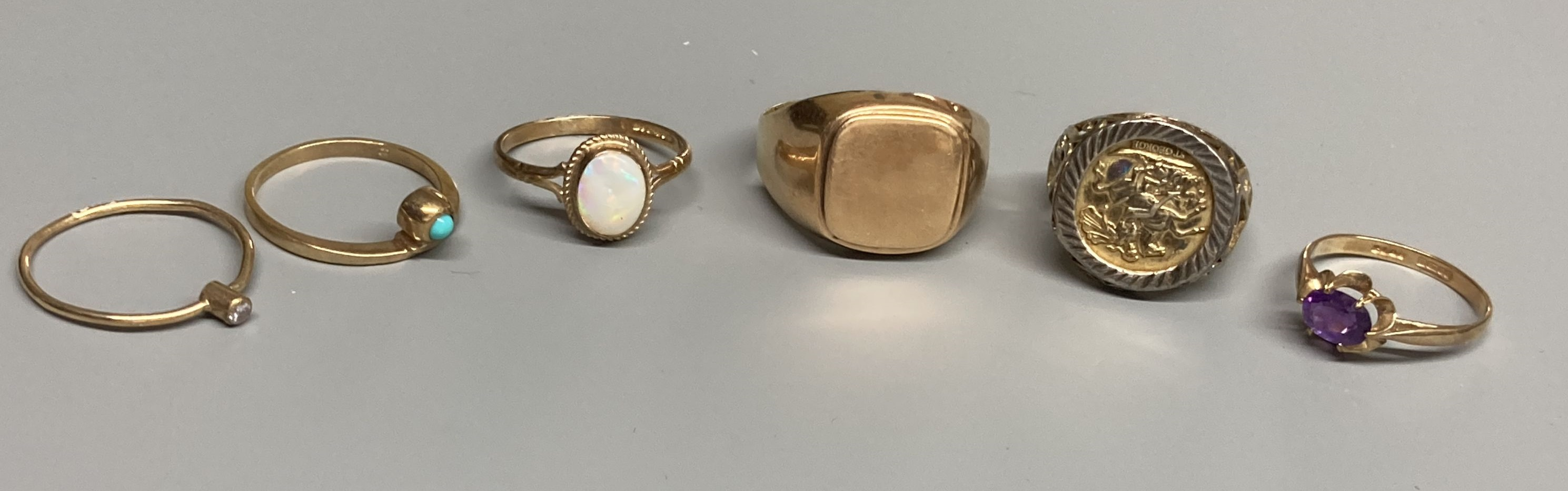 Four assorted modern 9ct gold and gem set rings, a 9ct gold signet ring(cut) and a white metal