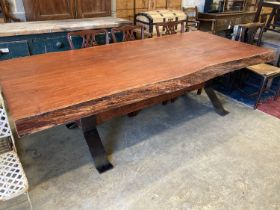 A South African Camelthorn hardwood dining table with a metal x-frame base, length 256cm, width