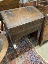 A 17th century oak slant front bible box, raised on a stand, width 61cm, depth 37cm, height 87cm