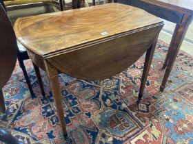 A George III rosewood banded and inlaid mahogany oval Pembroke table, width 79cm depth 49cm,