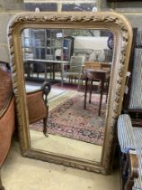 A Victorian arched giltwood overmantel mirror, width 80cm, height 118cm