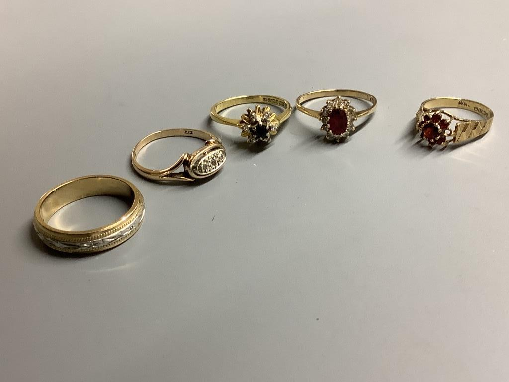 An 18ct gold, sapphire and diamond ring, gross 3.2 grams and four 9ct gold rings, two gem-set, gross