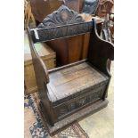 A small Flemish carved oak box seat settle, width 65cm, depth 40cm, height 104cm