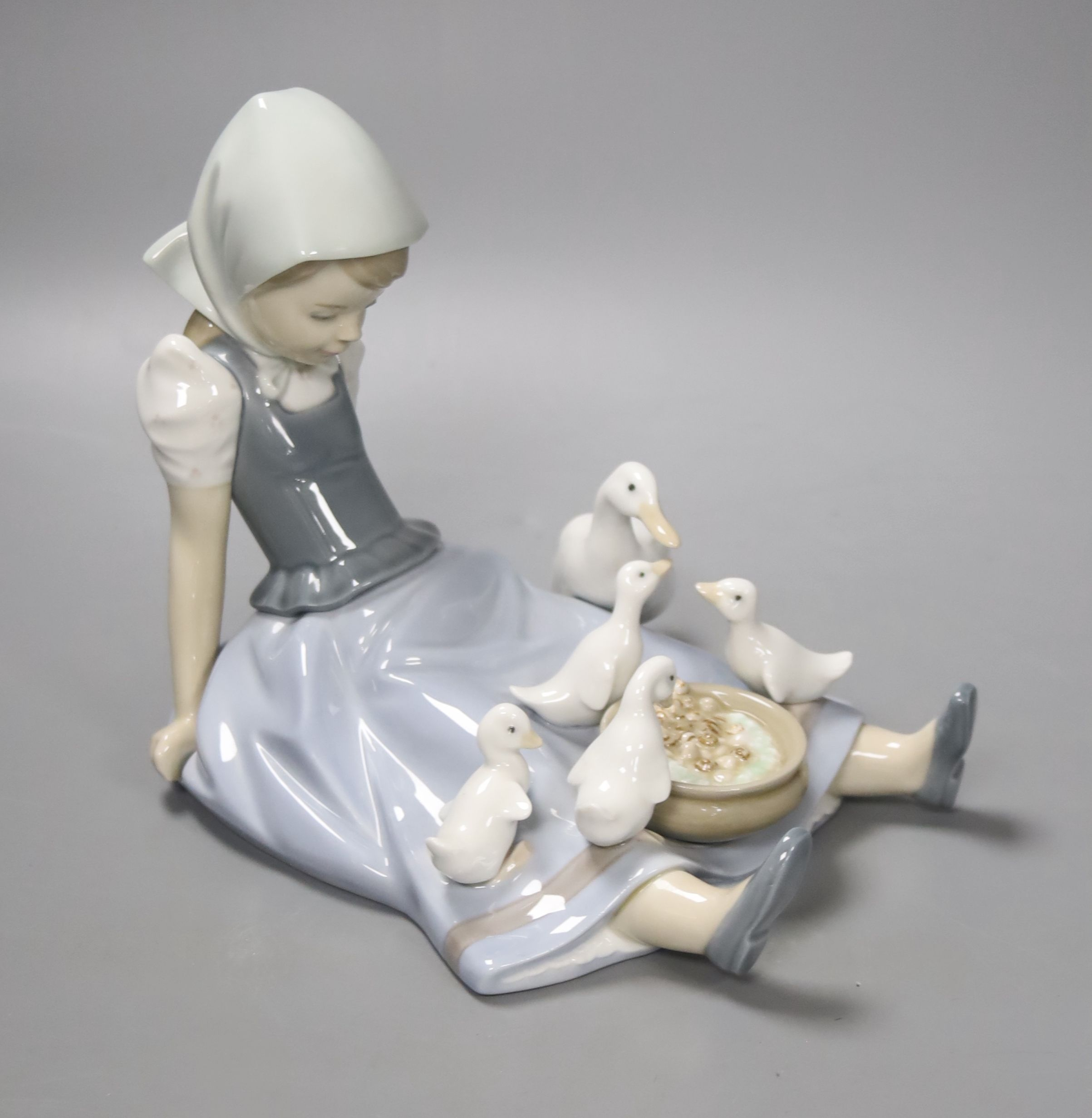 A Lladro group 'My Hungry Brood', no 5074, 17cm high