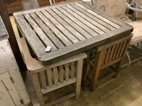 A Heals type weathered square teak garden table, 90cm, height 72cm and four chairs