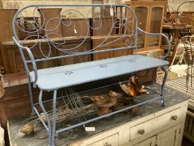 A painted wrought iron garden bench, length 123cm, depth 50cm, height 93cm