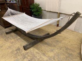 A weathered teak framed garden hammock, length 440cm, depth 130cm, height 120cm