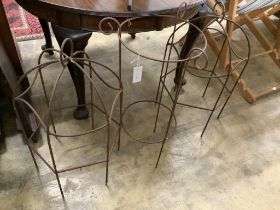 Three wrought iron growing frames