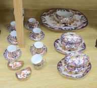 A collection of Royal Crown Derby Imari patterned ceramics including cups, side plates and platter