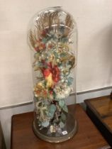 A Victorian fabric floral display under glass dome, height 78cm