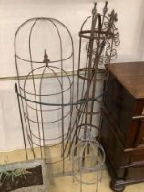 Nine assorted wrought iron growing frames and stakes, largest 148cm high