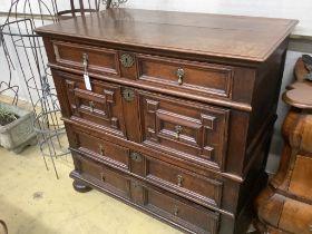 An 18th century oak geometric moulded two part chest, width 105cm, depth 58cm, height 100cm