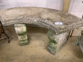 A reconstituted stone curved garden seat, length 110cm, depth 44cm, height 44cm