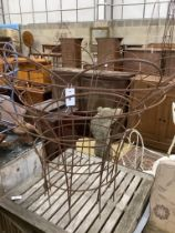 A pair of large circular wrought iron plant frames, diameter 120cm, height 96cm
