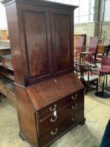 A George III mahogany bureau cabinet, width 114cm, depth 58cm, height 222cm