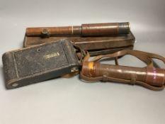 A cased telescope, another telescope and a Kodak camera