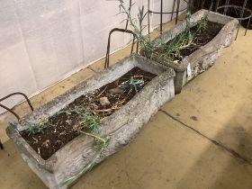 A pair of reconstituted stone serpentine front rectangular garden planters, width 73cm, depth