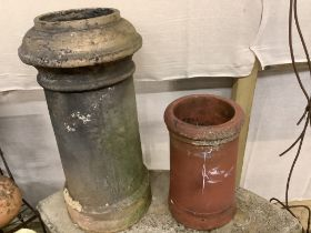 Two pottery chimney pots, larger 76cm high