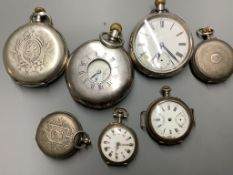 A silver half hunter pocket watch and six other white metal pocket or fob watches