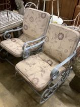 A pair of painted wrought iron garden rocking armchairs with cushion seats, width 57cm, depth
