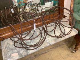 A pair of ball shaped wrought iron growing frames, 40cm diameter